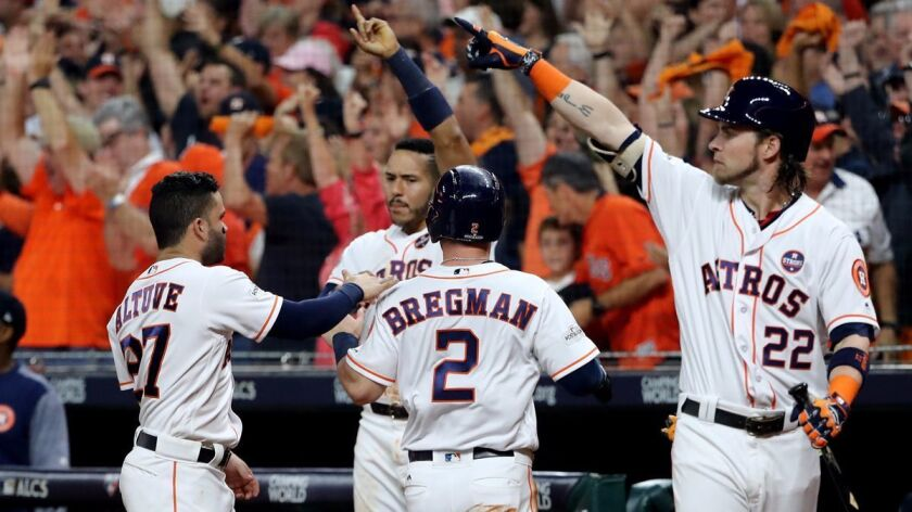 Houston Astros' Alex Bregman (2) celebrates with his teammates after scoring off of a Brian McCann RBI double against the New York Yankees during the fifth inning in Game 6 of the ALCS on Friday.