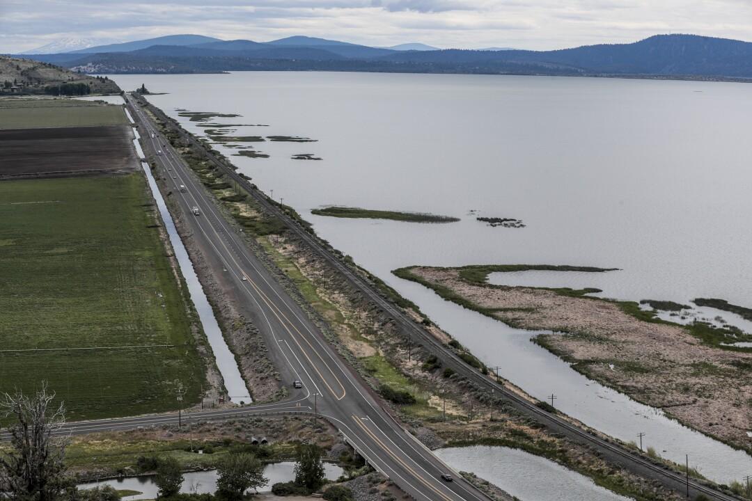 Highway 97 separates farmland from the Upper Klamath Lake in Oregon.