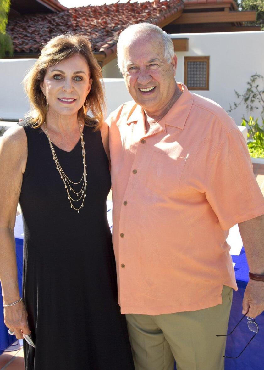 Host Linda Brandes with Helen Woodward Animal Center CEO Mike Arms
