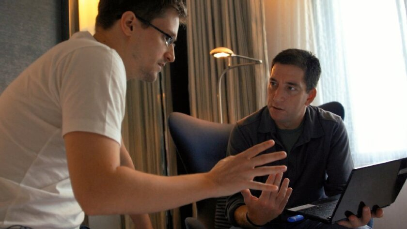 """Edward Snowden, left, appears with Glenn Greenwald in a scene from """"Citizenfour."""""""