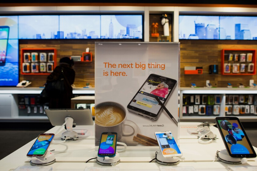 Samsung smartphones and devices at an AT&T; store in New York. Such devices typically are sold with electronic locks that prevent them from being used on a rival carrier's network.