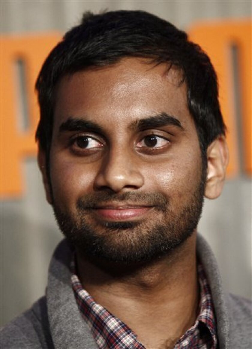 "FILE - In this Nov. 11, 2009 file photo, actor Aziz Ansari arrives at Puma's African Bazaar event in Los Angeles. Ansari, a star of NCBC's ""Parks and Recreation,"" is the host of the MTV Movie Awards, scheduled for Sunday June 6, 2010 at the Gibson Amphitheatre. (AP Photo/Matt Sayles, file)"