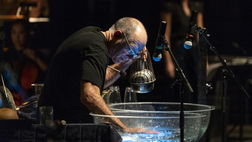 Music Director Steven Schick gives up his baton to solo in Tan Dun's Water Concerto, with Michael