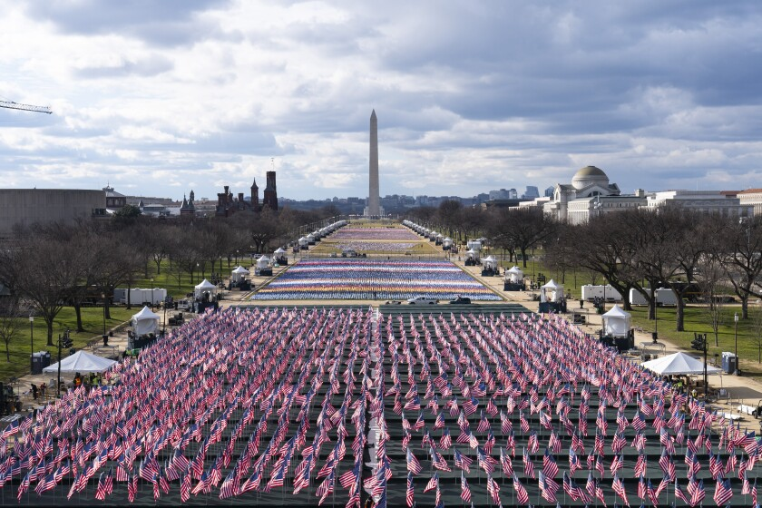 Flags are placed on the National Mall, looking toward the Washington Monument