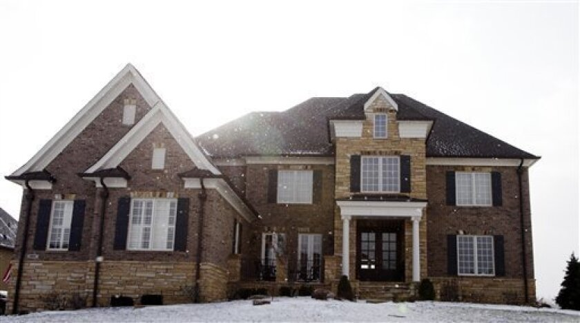 Light snow falls on the home of missing Indiana businessman Marcus Schrenker in McCordsville, Ind., Tuesday, Jan. 13, 2009. Federal marshals on Tuesday pressed their search for the investment manager they believe faked a distress call before parachuting from his plane over Alabama and disappearing