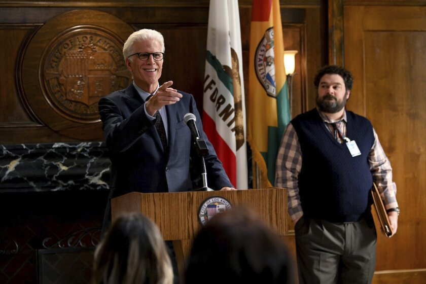 "This image released by NBC shows Ted Danson as Mayor Neil Bremer, left, and Bobby Moynihan as Jayden Kwapis in a scene from the new comedy ""Mr. Mayor,"" premiering on Thursday. (Mitchell Haddad/NBC via AP)"