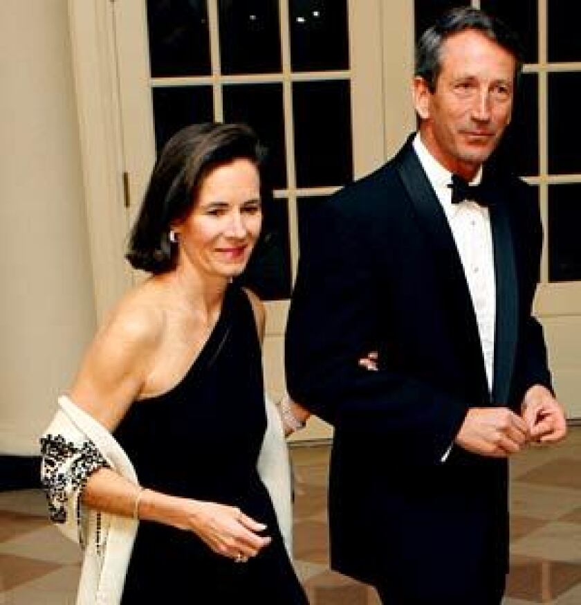 """Jenny and Mark Sanford attend a White House dinner hosted by President Obama. Jenny Sanford's memoir, """"Staying True,"""" details a difficult marriage."""