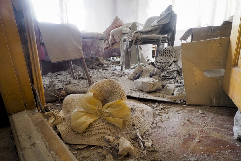 A view of a room of a house damaged by shelling in Stepanakert.