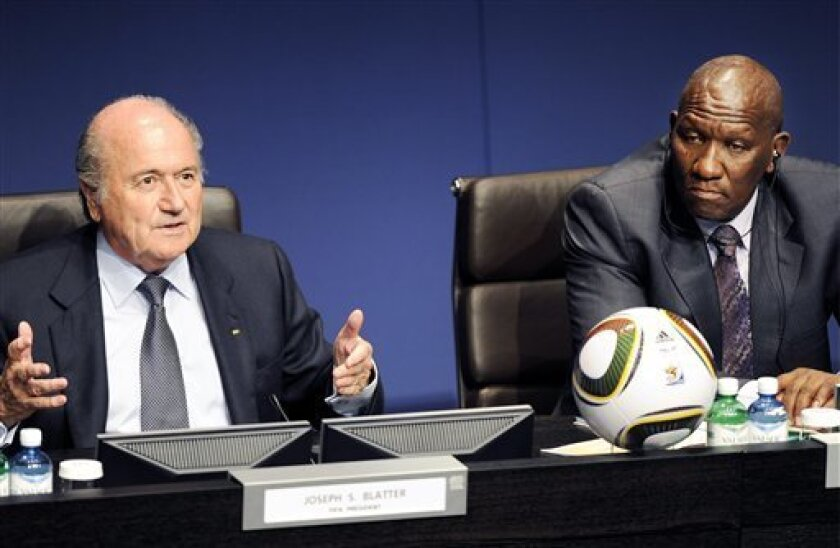 Josep S. Blatter, left, FIFA - President and Cele Bhekokwakhe, right. Chief South African Police during a press conference in Zurich, Switzerland, Friday, March 5, 2010. The 2010 FIFA soccer World Cup security workshop is taking place on March 4 and 5, at the Headquarters of FIFA in Zurich. Police representatives and Chiefs of Security of the 32 participating national teams will come together. (AP Photo/keystone/Walter Bieri)