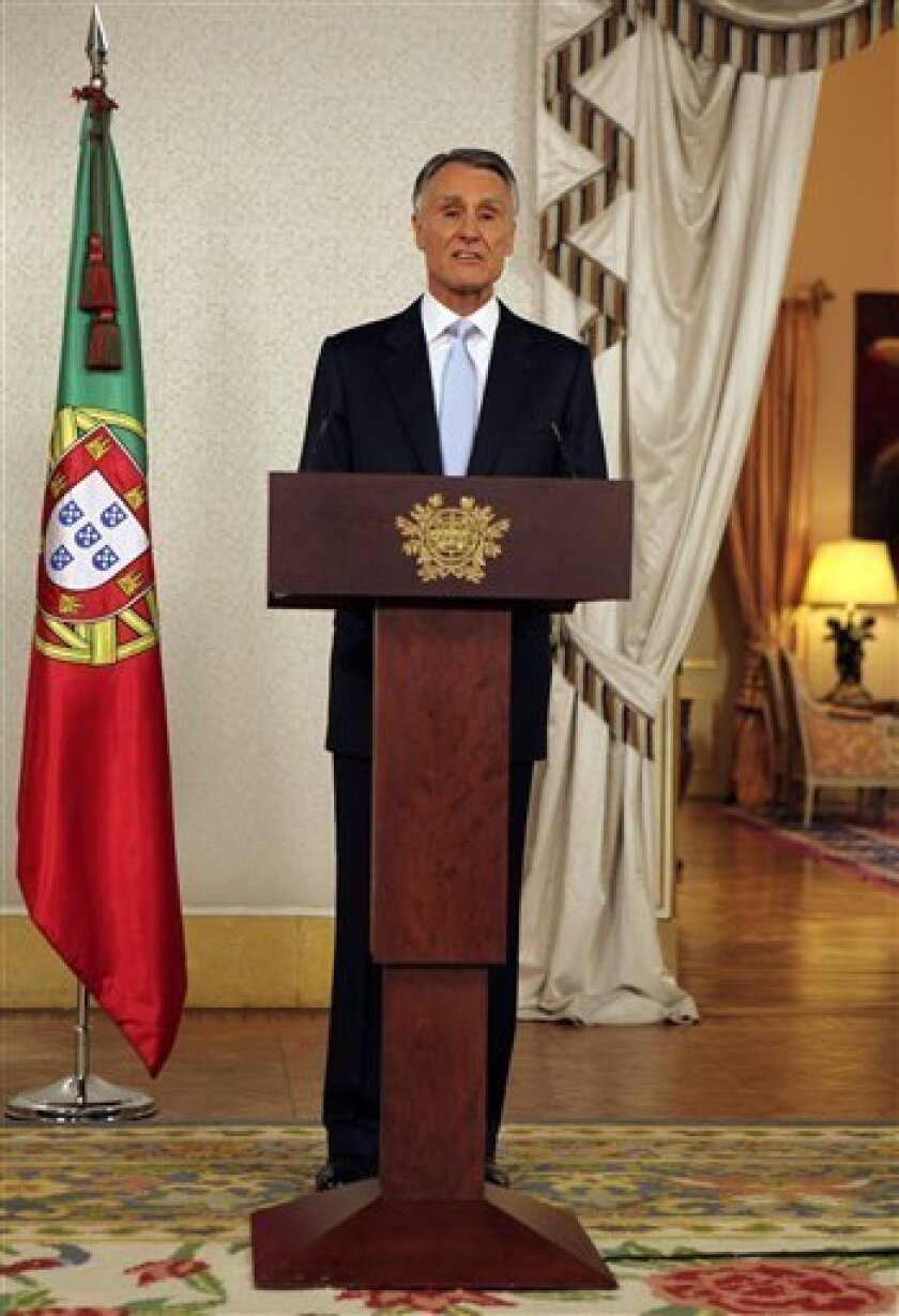 Portuguese Presidente Anibal Cavaco Silva addresses the country Thursday, March 31 2011, announcing that general elections will be held on May 5, at the Belem presidential palace in Lisbon. The president decided to call elections after the government quit last week in a dispute with opposition parties over a new batch of measures to restore the country's fiscal health. (AP Photo/Armando Franca)