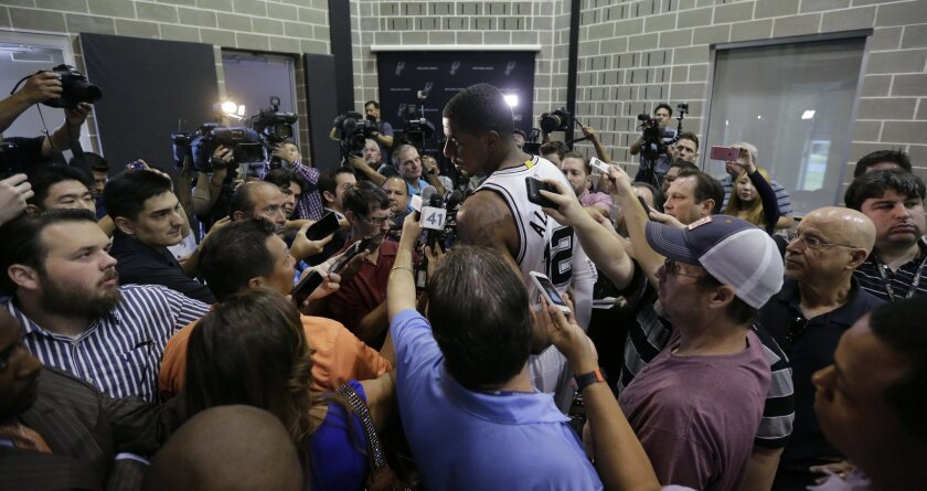 San Antonio Spurs' LaMarcus Aldridge (12) is surrounded as he gives an interview during media day, Monday, Sept. 28, 2015, in San Antonio. (AP Photo/Eric Gay)