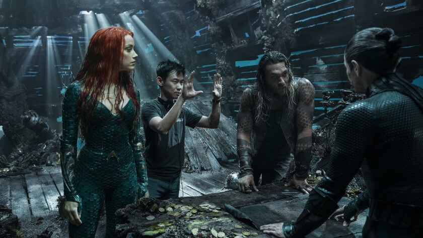 (L-r) AMBER HEARD, director JAMES WAN, JASON MOMOA and WILLEM DAFOE on the set of Warner Bros. Pictu
