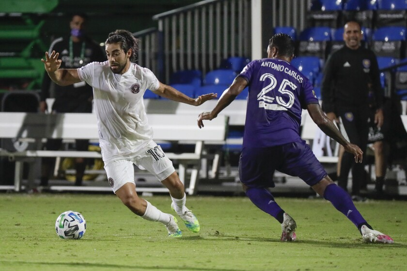 Inter Miami's Rodolfo Pizarro moves the ball past Orlando City's Antonio Carlos during the second half in Kissimmee, Fla.