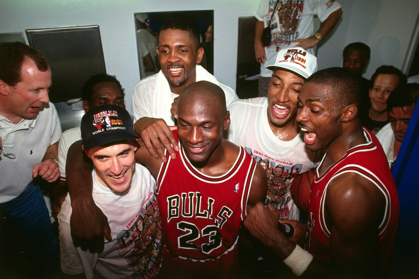 Michael Jordan and the Chicago Bulls celebrate following Game Five of the 1991 NBA Finals