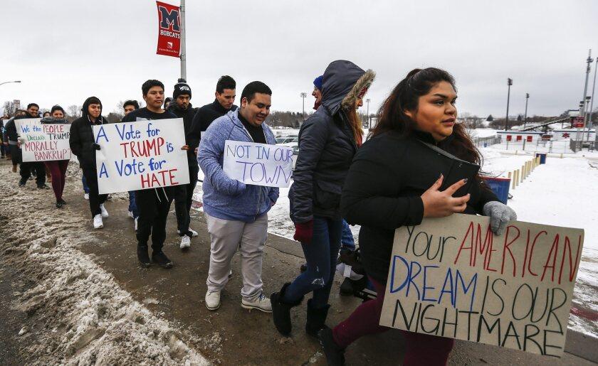 Activists protest against Donald Trump in Iowa