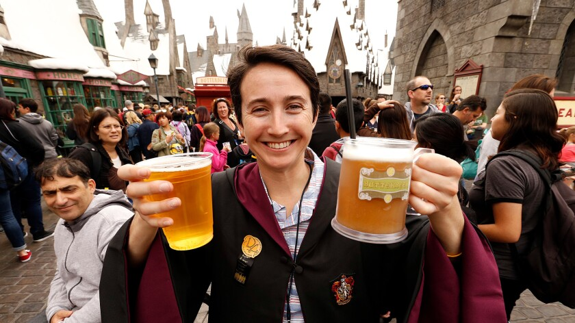 Sereena Worino hoists butterbeer while visiting the Wizarding World of Harry Potter attraction at Universal Studios Hollywood in April.