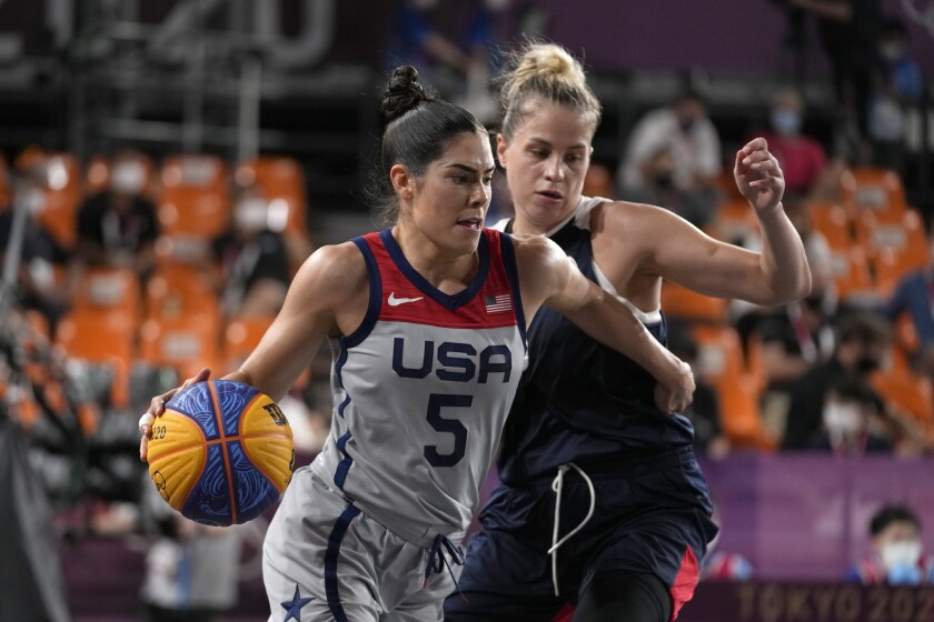 Kelsey Bloom leads basketball past Olga Frolkina of the Russian Olympic Committee at the Tokyo Olympics