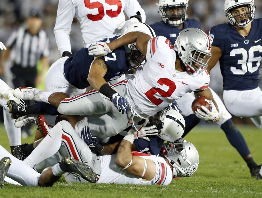 Ohio State running back J.K. Dobbins is tackled.