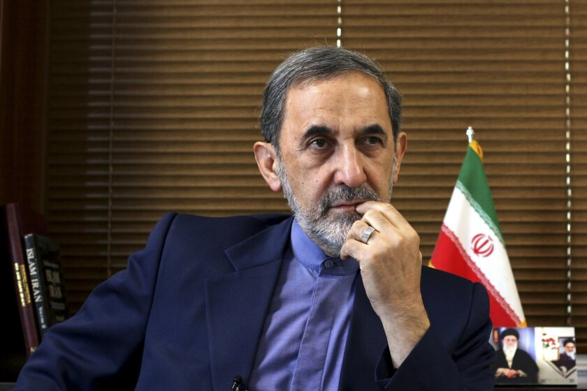 FILE - In this Sunday, Aug. 18, 2013, file photo, Ali Akbar Velayati, a top adviser to Iran's supreme leader Ayatollah Ali Khamenei, gives an interview to The Associated Press at his office, in Tehran, Iran. Velayati accused of masterminding Argentina's worst terrorist attack said Monday, May 18, 2015, that he is innocent and dismissed the accusations against him as baseless. The 1994 bombing of the AMIA Jewish community center that killed 85 people remains unsolved. Former Iranian officials have been on an Interpol capture list for years, but Argentine prosecutors have never been able to question them, and Iran has long denied any role in the bombing. (AP Photo/Ebrahim Noroozi, File)
