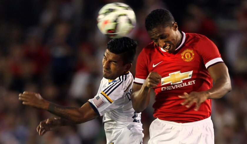 Galaxy's A.J. Delagarza, left, goes for a header against Manchester United's Danny Welbeck at the Rose Bowl in July.