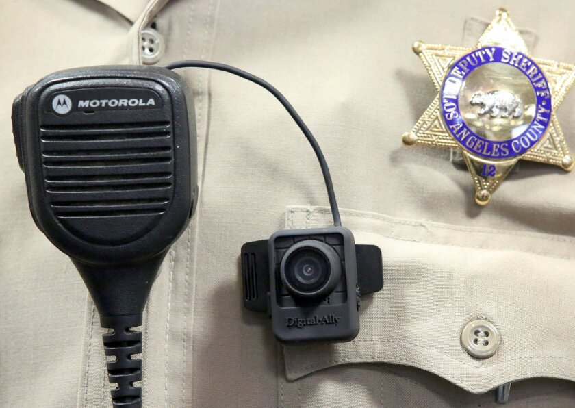 A body camera is displayed at a news conference at the Sheriff's Headquarters in the Monterey Park section of Los Angeles on Monday, Sept. 22, 2014. Dozens of sheriff's deputies at selected stations in Los Angeles County are testing body cameras during a six-month pilot program, officials said Mond
