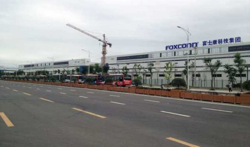 After reports of dangerous working conditions at Foxconn¿s Chinese factories, Apple and its suppliers agreed to allow the Fair Labor Assn. to inspect three Foxconn facilities in February and March. Above, the Foxconn factory in Chengdu, China.