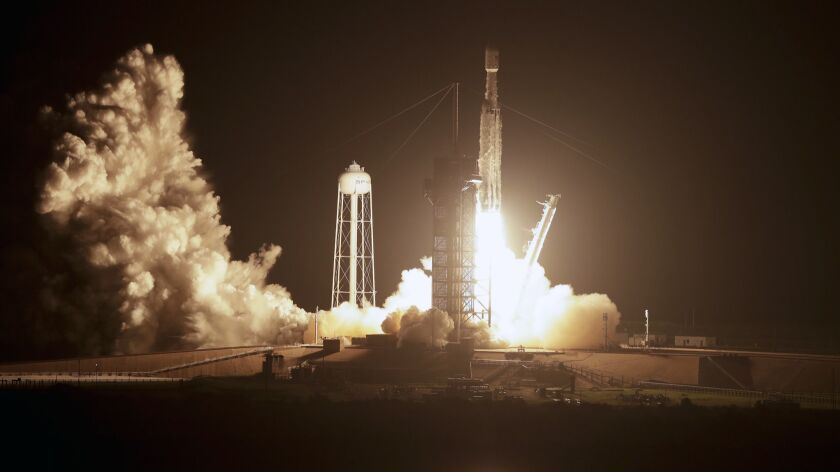 A SpaceX Falcon heavy rocket lifts off from pad 39A at the Kennedy Space Center in Cape Canaveral, F