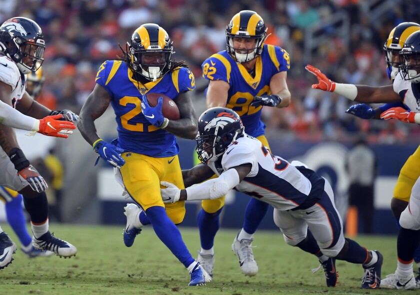 Rams running back Darrell Henderson runs through the Denver Broncos' defense during Saturday's preseason win.