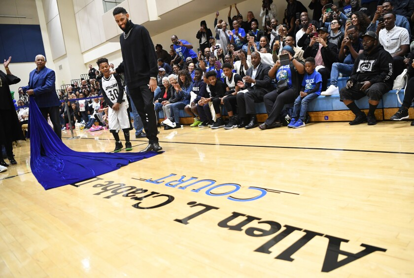 Allen Crabbe watches as his name is unveiled on the court at the Crenshaw Christian Center, home of Price High.
