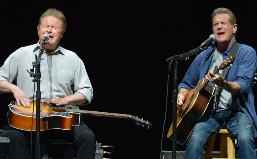 """FILE - In this Jan. 15, 2014 file photo, Don Henley, left, and Glenn Frey of The Eagles perform at the Forum in Los Angeles. A list of six Kennedy Center honorees were announced Wednesday, which includes """"Star Wars"""" creator George Lucas, groundbreaking actresses Rita Moreno and Cicely Tyson, singer Carole King, rock band the Eagles and acclaimed music director Seiji Ozawa. (Photo by John Shearer/Invision/AP, File)"""