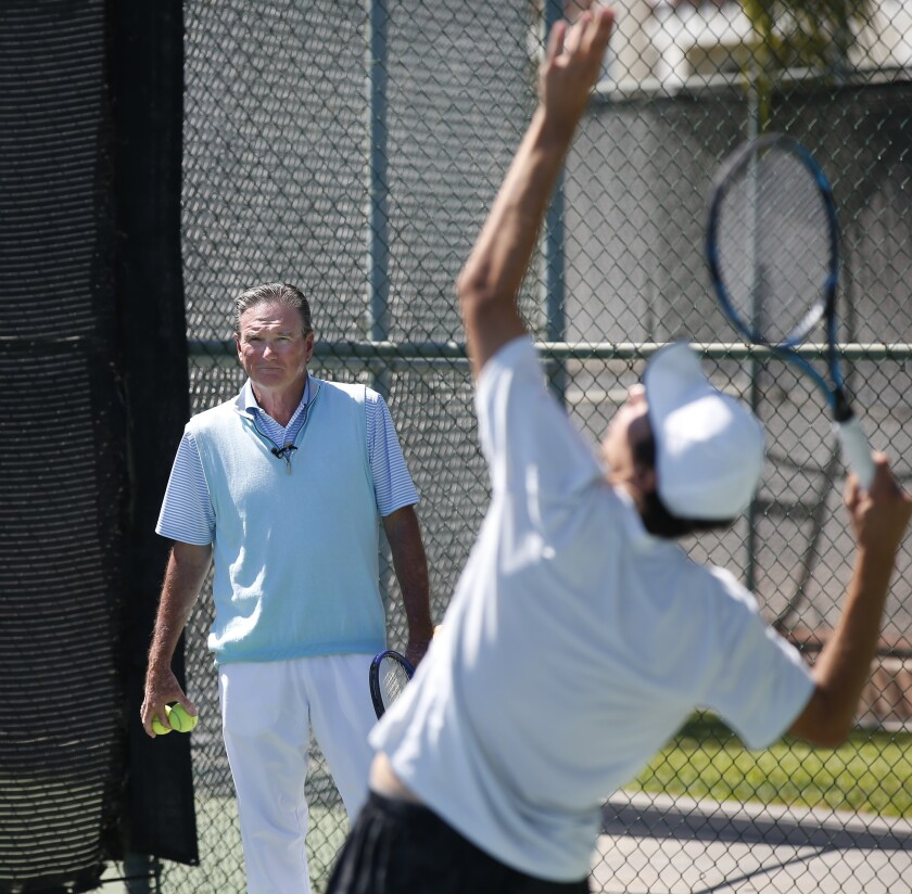 Tennis icon Jimmy Connors, shown working with Isaiah Strode at a camp Wednesday in Carlsbad, is part of a group trying to develop the first U.S. men's grand slam event winner since 2003.