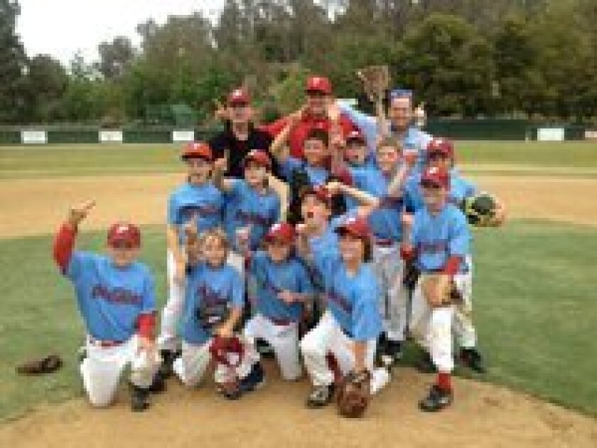 AAA League Champion - Phillies   Front L to R: Patrick Harrington, Burke Stratton, McCabe Moyer, Aiden Connelly; 2nd L to R: Reese Wazny, Jack Cheney; 3rd L to R: Cayden Caufield, Scott McCue, Tyler Buchner, Ryker Kile, Michael Sweeney, Charlie Mirer; Back: Asst. Coach Steve McCue, Coach Mike Sween
