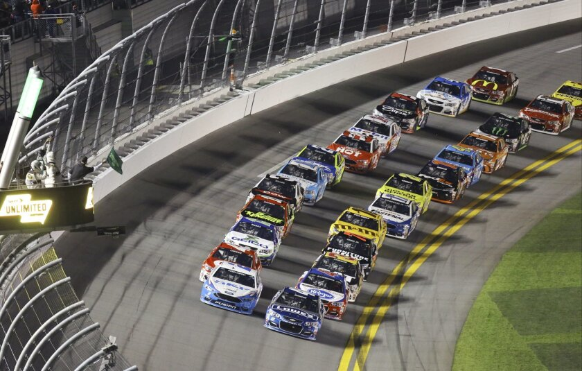 Jimmie Johnson, front right, and Brad Keselowski, front left, lead the start of the Sprint Unlimited auto race at Daytona International Speedway, Saturday, Feb. 13, 2016, in Daytona Beach, Fla. (AP Photo/David Graham)