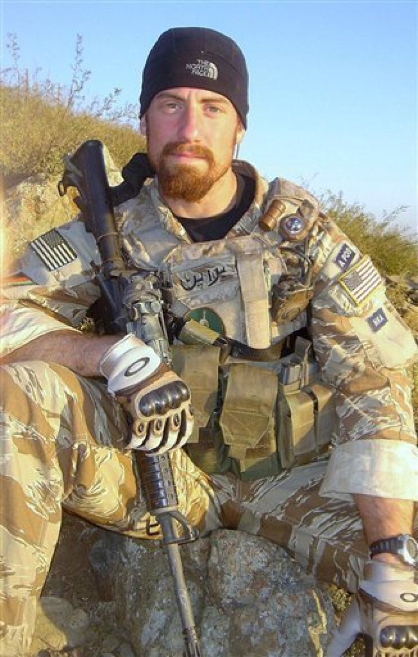 This is photo provided by family shows Darren James LaBonte, 35, in Afghanistan in 2007. LaBonte was one of seven CIA employees who died when a suicide bomber blew himself up at a U.S. base in Khost, Afghanistan on Dec. 30, 2009. LaBonte and the others were remembered at the American Airpower Museum at Republic Airport in Farmingdale, N.Y. on Memorial Day. As part of the ceremony, a B-17 bomber dropped flowers in the Atlantic Ocean not far from the site of the Twin Towers and the World Trade Center. (AP Photo/Courtesy of LaBonte's Family) NO SALES