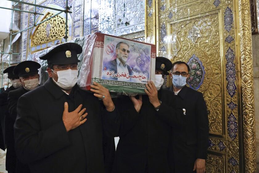 Caretakers from the Imam Reza holy shrine carry the coffin of slain Iranian nuclear scientist Mohsen Fakhrizadeh-Mahabadi.