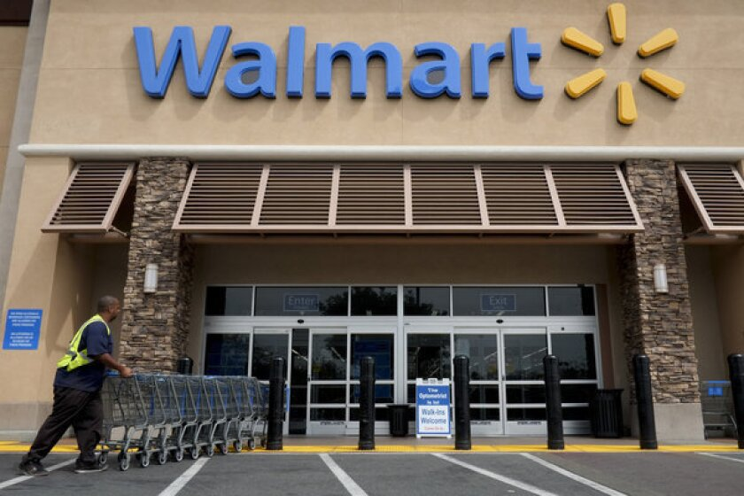 Wal-Mart is accused of labor violations a day after hiring a former advisor to President George W. Bush