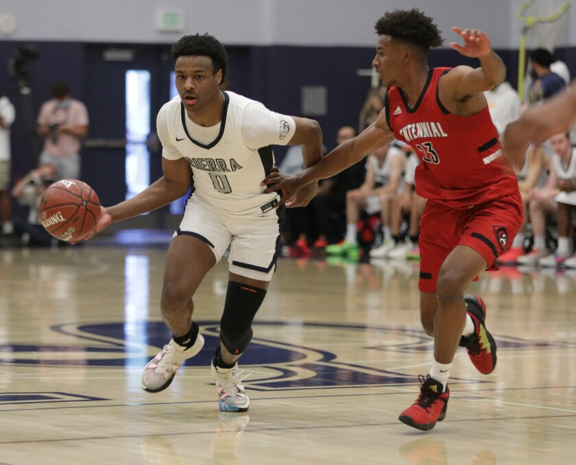 Sierra Canyon's Bronny James moves the ball up the court against Corona Centennial's Ramsey Huff.