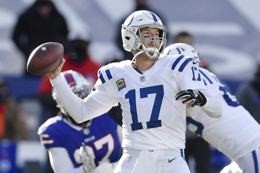 File- This Jan. 9, 2021, file photo shows Indianapolis Colts quarterback Philip Rivers (17) throwing a pass during the first half of an NFL wild-card playoff football game against the Buffalo Bills, in Orchard Park, N.Y. Rivers has won the Pro Football Writers of America's Good Guy Award for his cooperation with reporters, Tuesday, June 8, 2021. Rivers, who retired at 39 after one season with Indianapolis in 2020 following 16 years with the San Diego and Los Angeles Chargers, earned praise for consistently tackling all topics, even in a Zoom setting, and offering answers with perspective, wit and originality during his career.(AP Photo/Adrian Kraus, File)