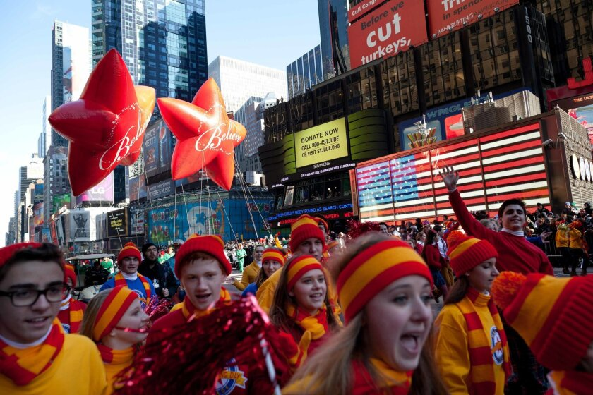 FILE - In this Nov. 24, 2011, file photo, Santa Claus's entourage marches through Times Square during the Macy's Thanksgiving Day Parade in New York. The Girl Scouts of the USA announced July 6, 2016, that the organization will be taking part in the parade for the first time ever this fall. (AP Pho