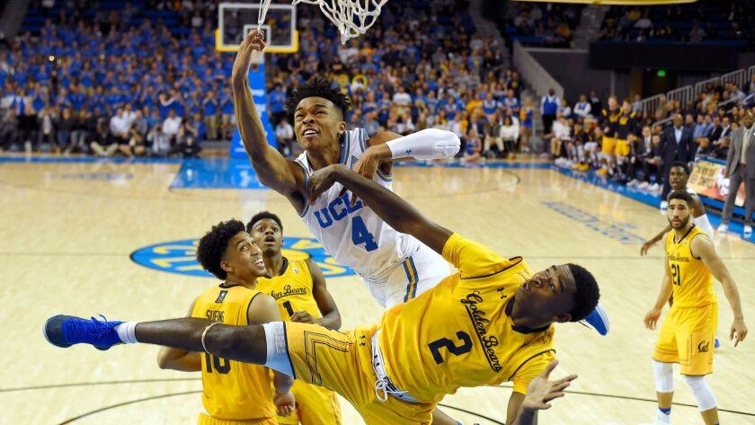 UCLA's Jaylen Hands falls along with California's Juhwan Harris-Dyson (2) after missing a dunk on Thursday.