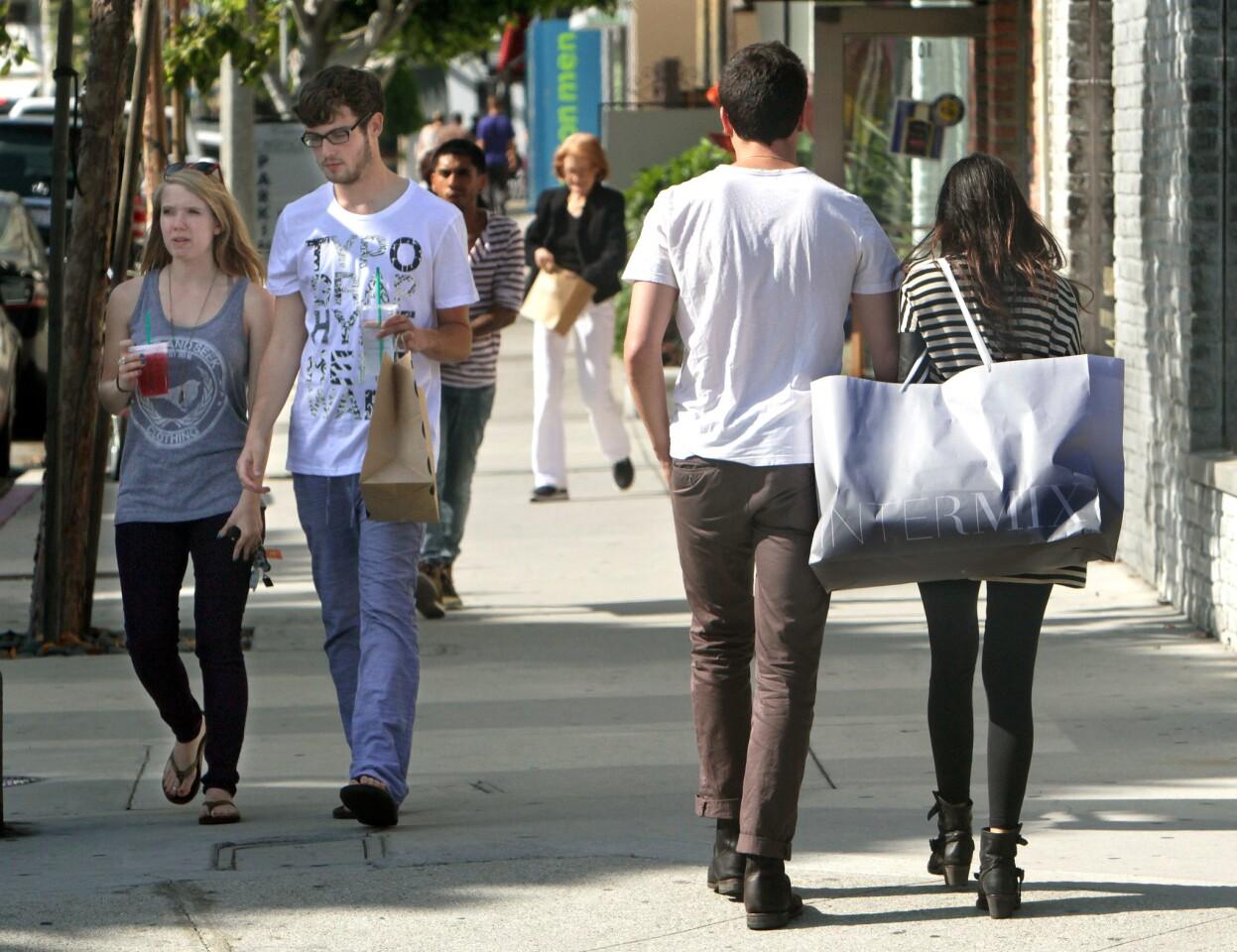 Shoppers near Alden Drive.