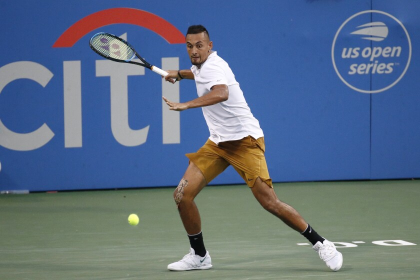 """FILE - In this Saturday, Aug. 3, 2019, file photo, Nick Kyrgios, of Australia, returns the ball to Stefanos Tsitsipas, of Greece, during a semifinal at the Citi Open tennis tournament in Washington. The tournament that was supposed to mark the official return of men's professional tennis amid the coronavirus pandemic has been canceled. The Citi Open in Washington, scheduled to start with Aug. 13 qualifying, was called off Tuesday, July 21, 2020, because of what tournament manager Mark Ein said are """"too many unresolved external issues, including various international travel restrictions as well as troubling health and safety trends.""""(AP Photo/Patrick Semansky, File)"""