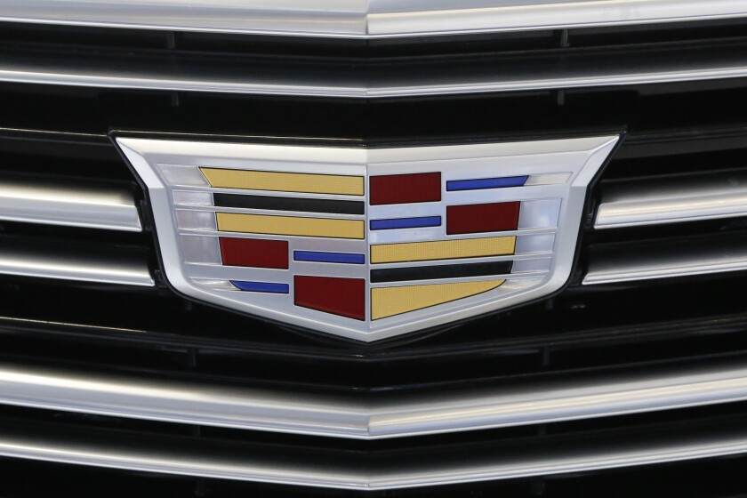 FILE - This Thursday, Feb. 11, 2016, file photo shows the Cadillac logo, a General Motors Co. brand, on display on a vehicle at the Pittsburgh International Auto Show in Pittsburgh. The U.S. government's road safety agency on Wednesday, Nov. 11, 2020, is investigating complaints that the rear suspensions on older Cadillac SUVs can fail, causing drivers to lose control and possibly crash. The probe by the National Highway Traffic Safety Administration covers about 344,000 SUVs from 2010 through 2015. (AP Photo/Gene J. Puskar, File)