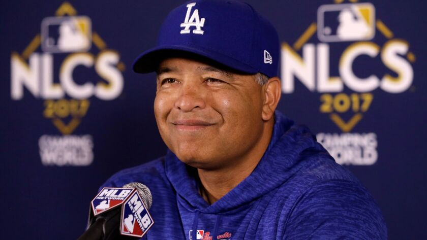 Dave Roberts talks to reporters during the 2017 National League Championship Series.