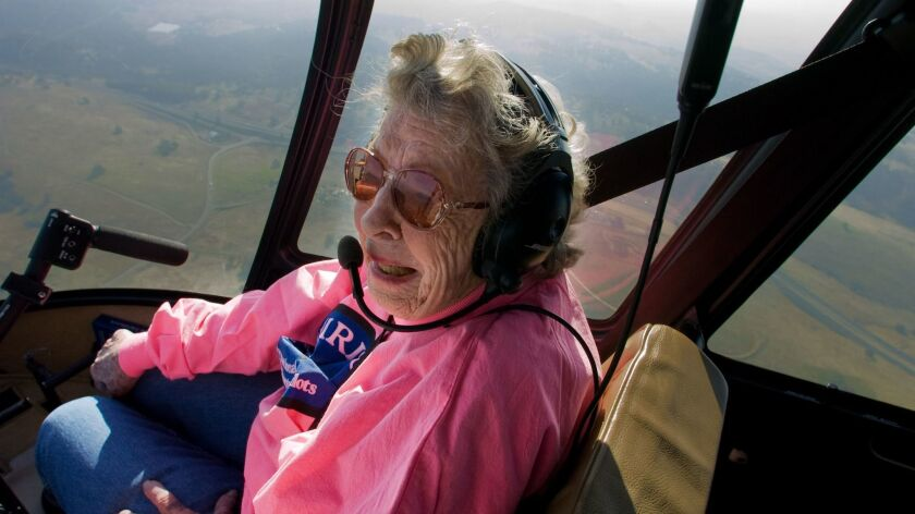 """Doris Lockness takes a ride in a helicopter in 2009. She mused about wanted to pilot one again, but said, """"I don't think they'll let me do it."""""""