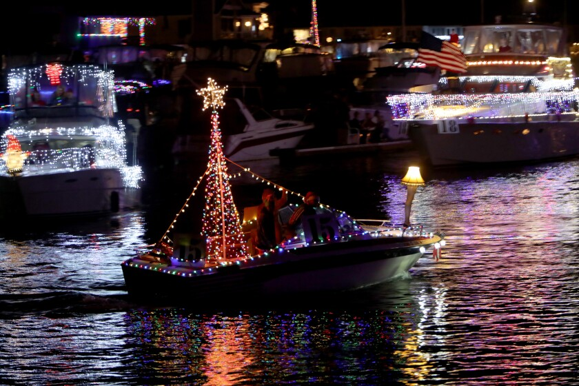 Lights decorate boats for a holiday parade.