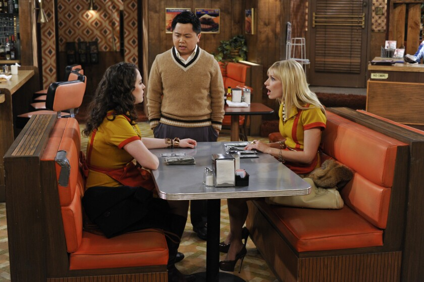 "Kat Dennings, left, Matthew Moy and Beth Behrs in a scene from CBS' ""2 Broke Girls."""