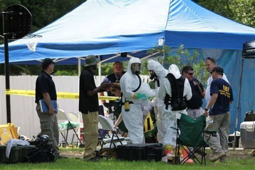 FILE - In this May 31, 2013 file photo, members of an FBI hazardous materials team prepare to enter a residence in New Boston, Texas in connection with a federal investigation surrounding ricin-laced letters mailed to President Barack Obama and New York Mayor Michael Bloomberg. Two U.S. law enforce