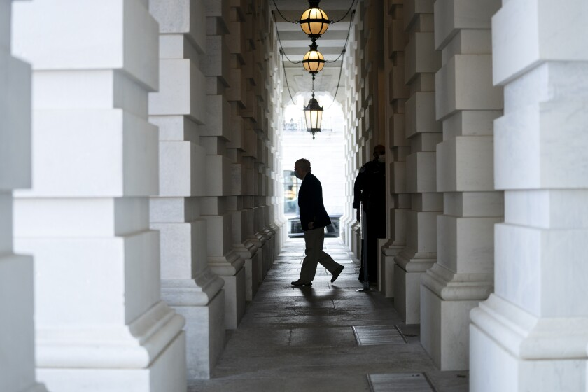 Senate Majority Leader Mitch McConnell's silhouette as he leaves the Capitol.