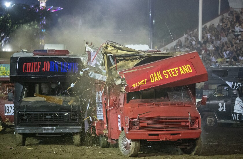 Newport Beach Police Chief Jon Lewis and Costa Mesa Fire Chief Dan Stefano go head to head during the Orange County Fair's Motorhome Madness demolition derby Friday night.